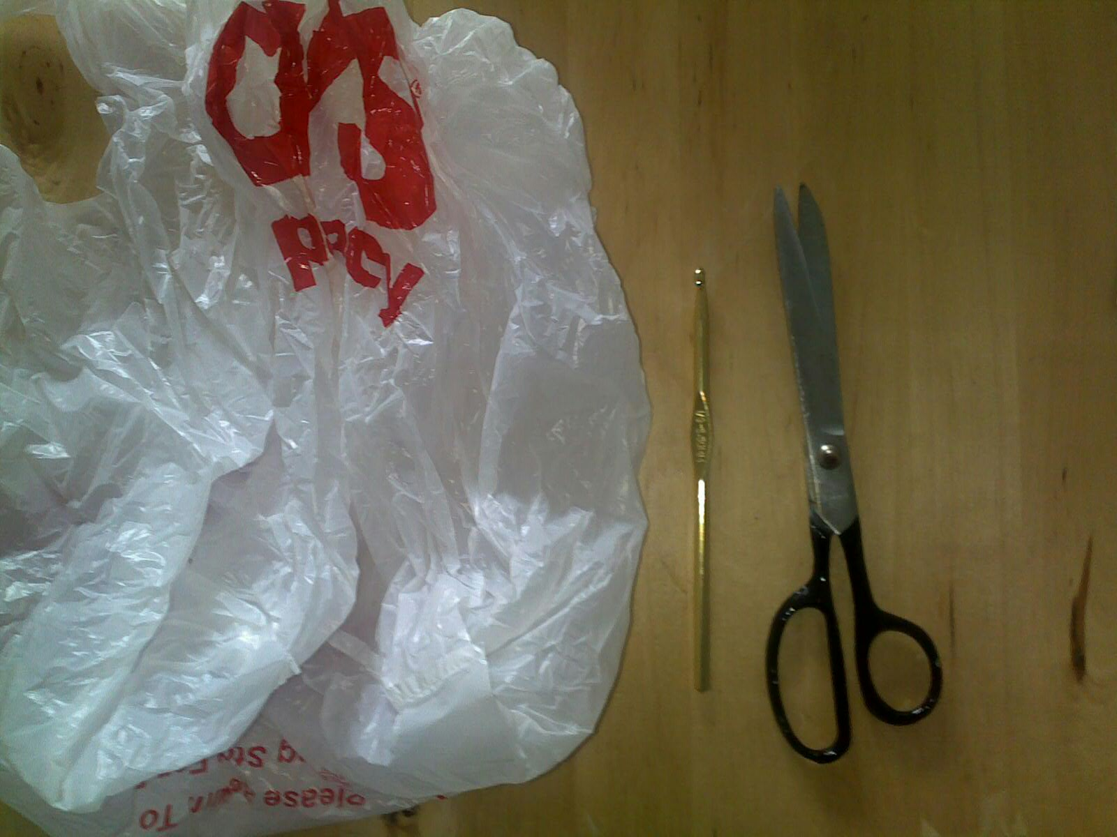 Crocheting With Plastic Bags : Step 1: Fold the plastic bag and cut one inch thick plastic strips ...